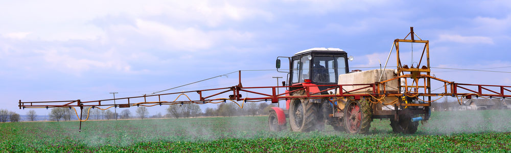 farmers applying RoundUp glyphosate