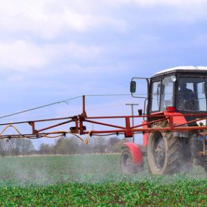 farmers applying RoundUp glyphosate